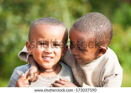 AKSUM, ETHIOPIA - SEP 27, 2011: Two unidentified Ethiopian little boys play together in Ethiopia, Sep.27, 2011.Children in Ethiopia suffer of poverty due to the unstable situation - stock photo