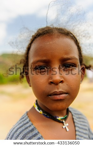 AKSUM, ETHIOPIA - SEP 24, 2011: Unidentified Ethiopian beautiful girl smiles for camera in Ethiopia, Sep.24, 2011. People in Ethiopia suffer of poverty due to the unstable situation