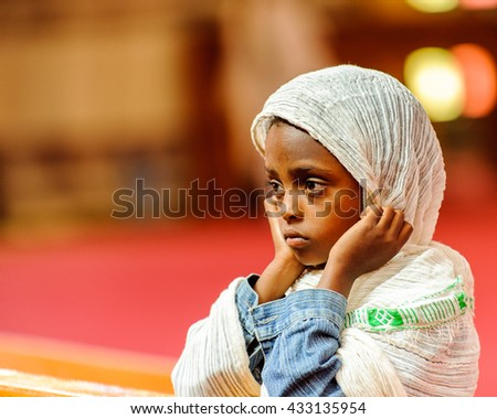 AKSUM, ETHIOPIA - SEP 24, 2011: Unidentified Ethiopian cute little girl wearing tissue in Ethiopia, Sep.24, 2011. Children in Ethiopia suffer of poverty due to the unstable situation - stock photo