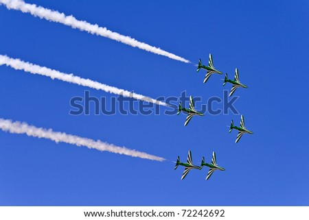 AL AIN, UAE - FEBRUARY 4: Saudi Hawks fly in formation at Al Ain Aerobatic show on February 4, 2011 in Al Ain, the United Arab Emirates.