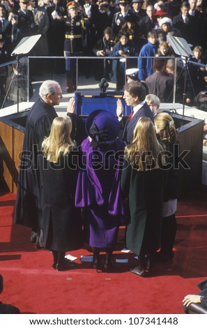 Al Gore, taking oath as Vice President on Inauguration Day from Chief Justice William Rehnquist on January 20, 1993 in Washington, DC - stock photo