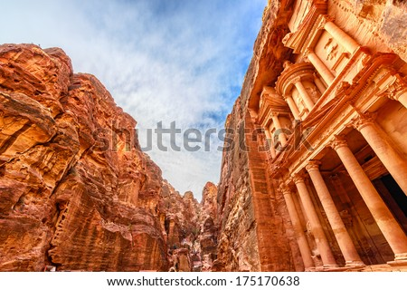 Al Khazneh in the ancient Jordanian city of Petra, Jordan. It is known as The Treasury. Petra has led to its designation as a UNESCO World Heritage Site. - stock photo