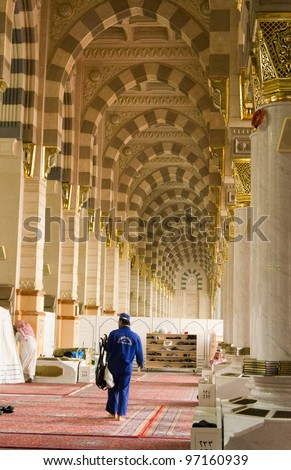 AL MADINAH, SAUDI ARABIA-FEB. 17: An unidentified worker cleans up and tidy up interior of Masjid Nabawi on February 17, 2012 in Al Madinah, S. Arabia. Nabawi mosque is the 2nd holiest mosque in Islam