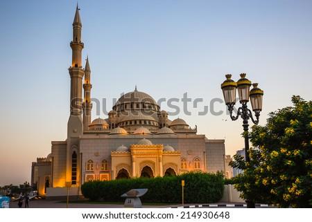 Al Noor Mosque in Sharjah at night. United Arab Emirates - stock photo