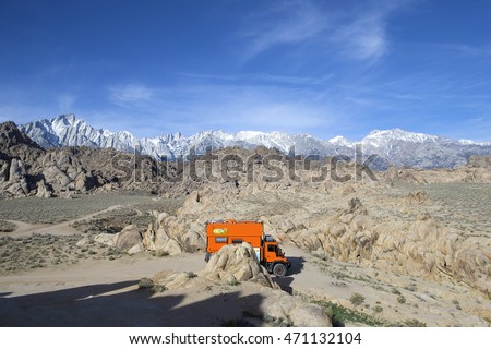ALABAMA HILLS RECREATIONAL AREA, CALIFORNIA, USA - MARCH 14, 2016: Camping with custom orange RV truck in Alabama Hills BLM.