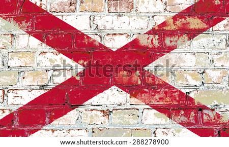 Alabama state flag of America on brick wall - stock photo