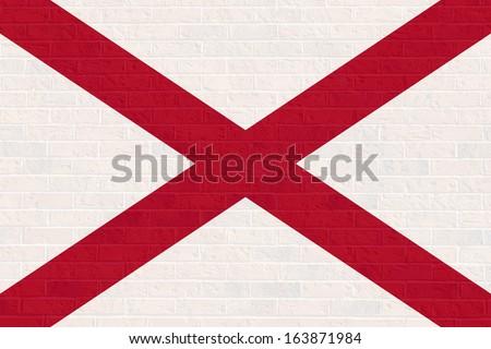 Alabama state flag of America on brick wall, isolated on white background. - stock photo