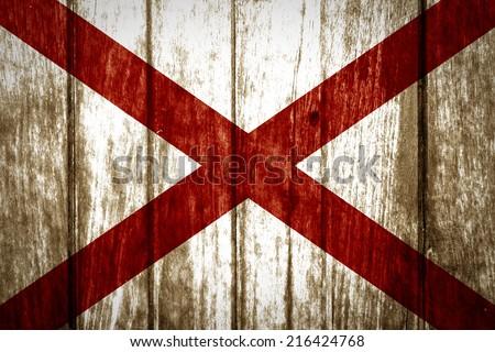 Alabama State Flag painted on old wood background  - stock photo
