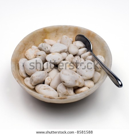 Alabaster bowl, pebbles and spoon