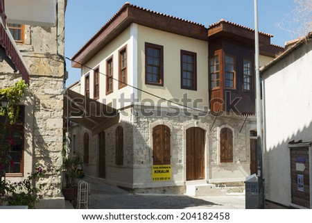 ALACATI, TURKEY -JULY 07, 2014:Alacati, well known for its architecture, vineyards and windmills is a popular summer tourist destination.