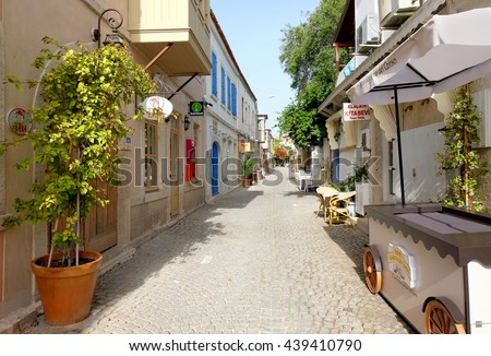 ALACATI, TURKEY - MAY 2016: Street view on May 13, 2016 in Alacati, Turkey. Alacati, well known for its architecture, vineyards and windmills is a popular summer tourist destination.