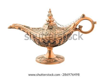 Aladdin magic lamp isolated on white. - stock photo