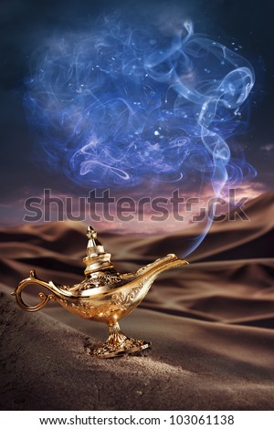 Aladdin magic lamp on a desert with smoke - stock photo