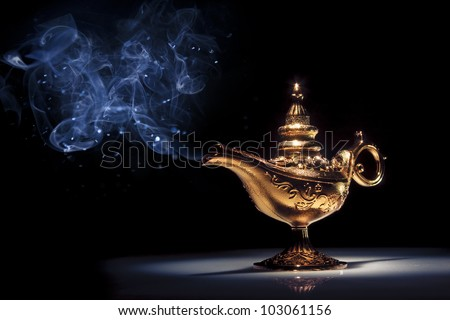 aladdin magic lamp on black with smoke