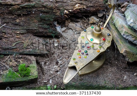 Aladdin's lamp on the old bricks, background or attic - stock photo