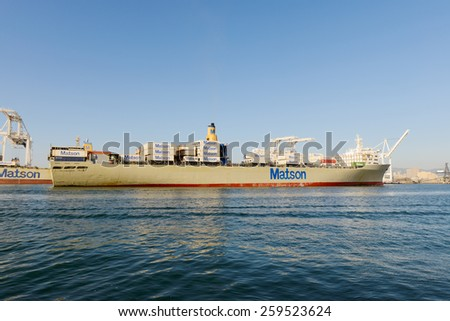"Alameda, CA - March 9, 2015: Oakland Oakland Container Shipyard, San Francisco Bay, the MATSON ship ""Manoa"" entering harbor, maneuvering into dock"