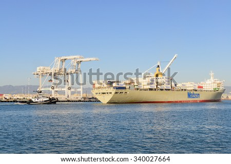"Alameda, CA - March 9, 2015: Oakland Oakland Container Shipyard, San Francisco Bay, the MATSON ship ""Manoa"" entering harbor, maeuvering into dock"