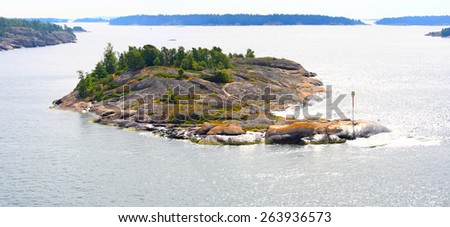 Aland Islands archipelago with its numerous tiny rocky islands in summer.
