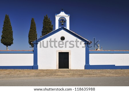 ALANDROAL, PORTUGAL - MARCH 2012 Terena cemetery and chapel with blue sky. - stock photo