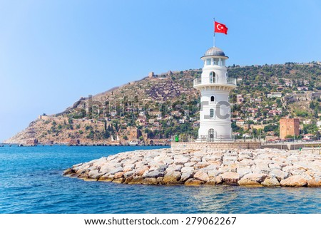 Alanya lighthouse with fortress and Red tower on the background
