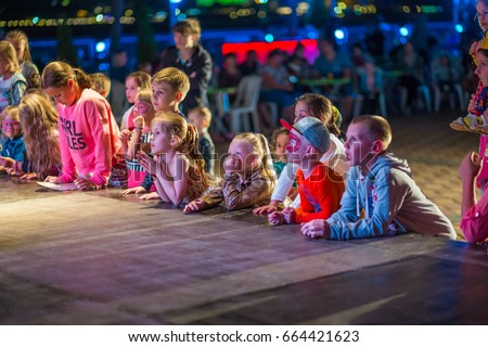 Alanya, Turkey - May, 7, 2017: Children watch the evening animation program. Children's disco in the Turkish resort. Mini disco for children.