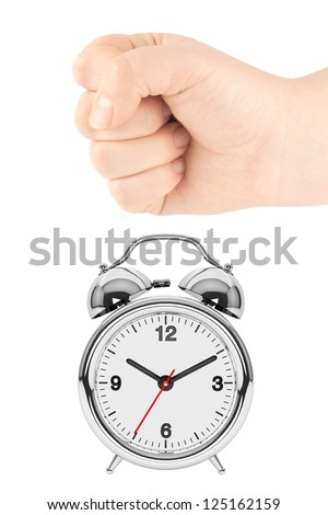 Alarm clock and a fist on the white background