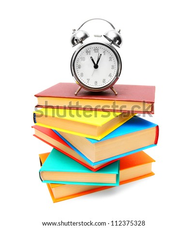 alarm clock and books . - stock photo