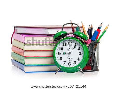 Alarm clock and books, isolated on white background - stock photo