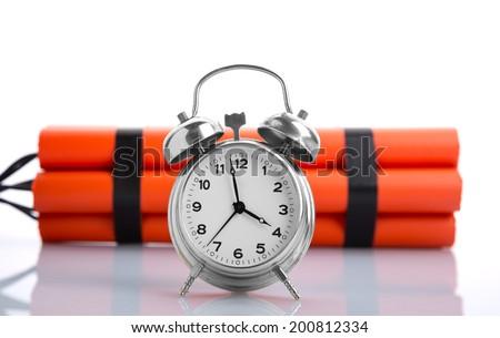 Alarm clock and dynamite - stock photo
