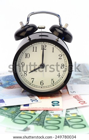 alarm clock and euro bills. time for money concept - stock photo