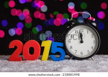 Alarm clock and figures in  2015. - stock photo