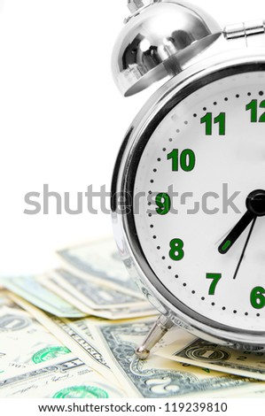 Alarm clock and money. On a white background.