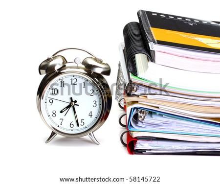 alarm clock, books, copy books and  folders on white background - stock photo
