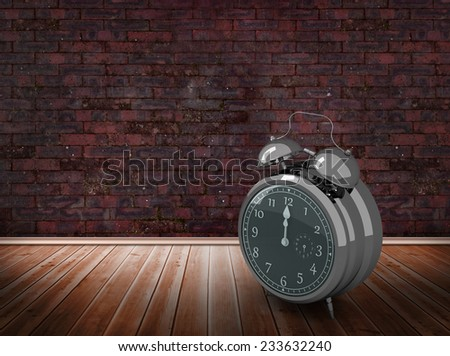 Alarm clock counting down to twelve against room with brick wall - stock photo