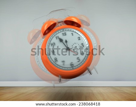 Alarm clock counting down to twelve against room with wooden floor - stock photo