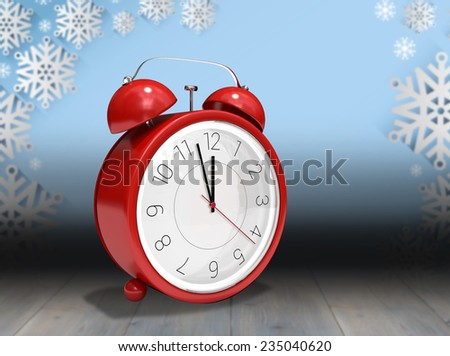 Alarm clock counting down to twelve against snowflake wallpaper over floor boards - stock photo