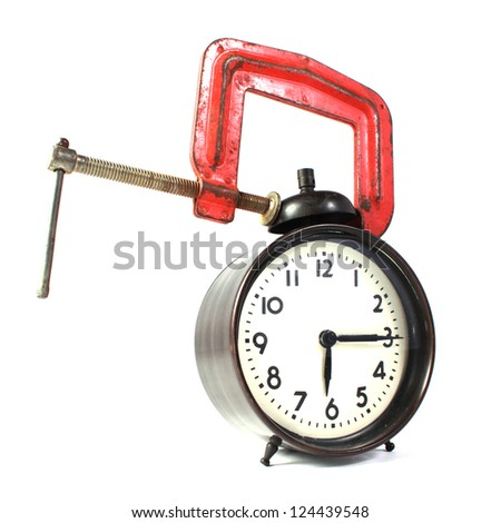 Alarm clock in a clamp - stock photo