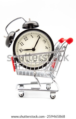 alarm clock in a shopping cart - stock photo