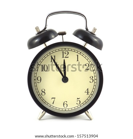 Alarm clock in black case and beige clockface shows 5 minutes to twelve isolated on white close up - stock photo