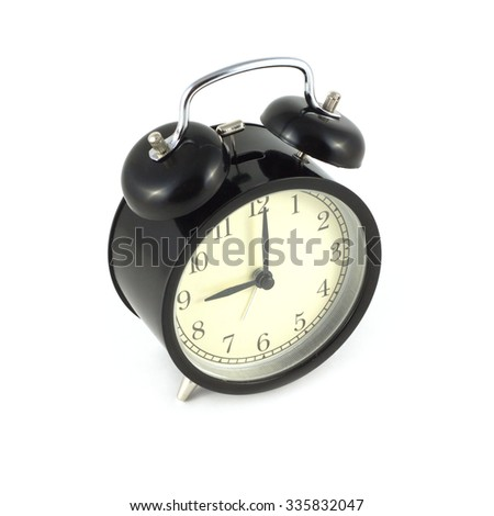 Alarm clock in black case shows 9 hours, photo isolated on white closeup