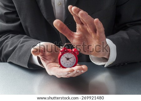 alarm clock in business hands - stock photo