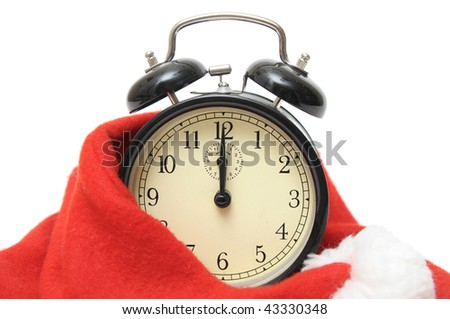 Alarm clock in the hat of Santa Claus