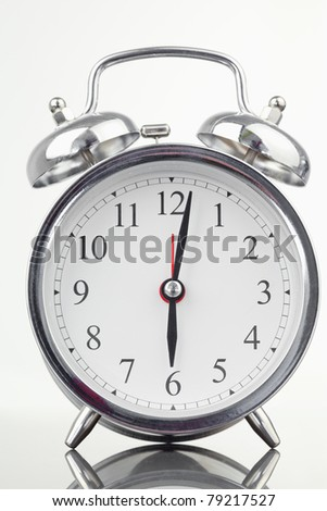 Alarm clock isolated against a white background