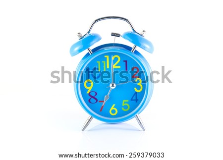 Alarm Clock isolated on white, in blue, showing seven o'clock.