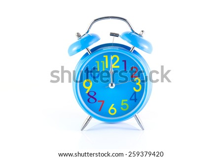 Alarm Clock isolated on white, in blue, showing twelve o'clock. - stock photo