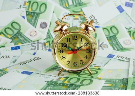 Alarm clock on a Euro banknotes
