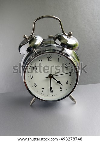 alarm clock on a gray background.