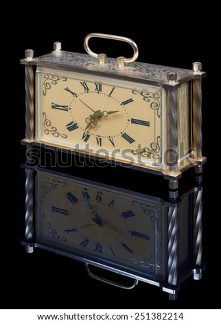 Alarm clock on black background and its reflection - stock photo