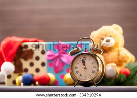 Alarm clock on christmas background