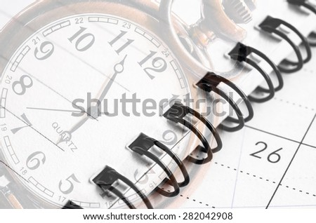 alarm clock on diary book. Style background. - stock photo